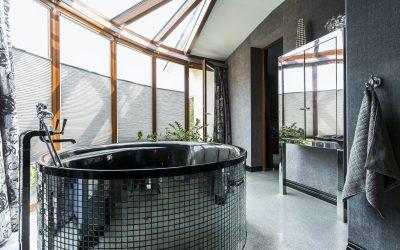 Luxurious bathroom with freestanding glossy bathtub
