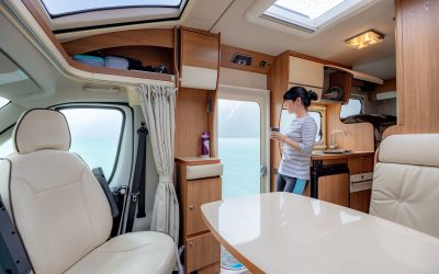 Woman in the interior of a camper RV motorhome with a cup of cof